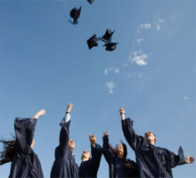 Graduating students throwing caps in the air
